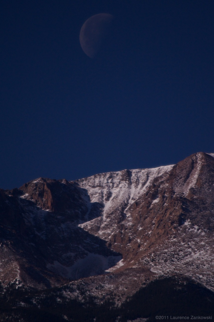 moon set over pikes peak - Dec. 17th, 2011. Colorado Springs-  warm and sunny morning, lots of athletes out running.