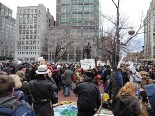 "carton-rouge:  Occupy Wall Street makes bid for new New York City camp  Occupy protesters played drums, cymbals and  trombones, held group  meetings and waved signs with a variety of messages — ""Disobedience is   civil"" and ""Sorry to inconvenience your apathy"" — as they marked the  movement's third-month anniversary with a major direct action that could  give them a new home as authorities continue to shutter camps  nationwide.  A few hundred protesters — flanked by police  officers — coalesced on a nearly half-acre plot about one mile  northwest of their former camp at Zuccotti Park. But their potential new  landlord at Duarte Square, Trinity Church, has voiced strong  opposition, and the move by Occupy is seen by some as applying strong  pressure to them to cave in and let the protesters install themselves. Under  the banner of ""Re-Occupy,"" the protesters said more than 1,400 people  — elders of the civil rights movement, prominent artists, faith leaders  and community members — will help them try and set up camp there after  they were evicted from Zuccotti Park on Nov. 15. ""I'm just loving  seeing everybody from Zuccotti Park and it really puts an exclamation  point on the (question) that's been asked today so many times, 'Do you  guys need a space?' … and the answer is, 'yes.' When you walk around  and see the familiar faces and the kindred spirits and the unification  of effort, then you realize yes we do need a space so that we can all be  together and function as whole as a group and move forward, no doubt,""  said Thorin Caristo, a 37-year-old protester who is part of an  independent livestream team."