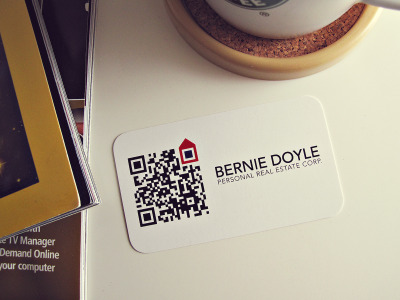 Bernie Doyle QR Business Card Realtors are always on the go. Information has to stay relevant even on printed materials. This is where QR Code comes into play. It serves as a portal to the realty network and will always be updated with new listings. When Bernie Doyle approached Allegra Marketing to have his logo and business card redesigned, we immediately knew what to do with it. The idea behind the logo is inspired by Google's location tag. The code can be easily swapped yet his logo will still look the same no matter what.