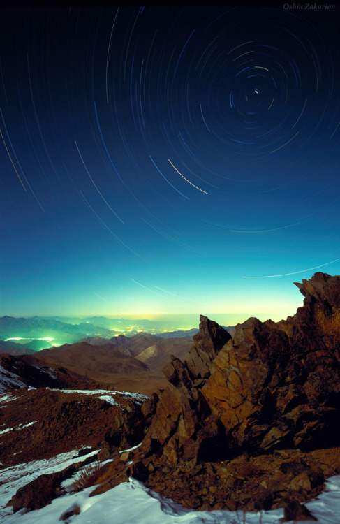 Stars and Rocks  Photographed from the top of 3600-meter Mount Gargash, northern stars trail around the celestial pole as seen above Zagros Mountains of Iran during this one-hour exposure with a film camera.  By Oshin D. Zakarian
