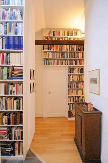 Floor to ceiling bookshelves in a home library (via My Ideal Home)