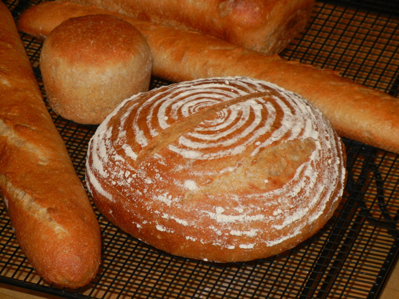happybreadhouse:  Day one of my Holiday Bread-tacular! I was aiming for baguettes, but I managed to run out of white flour and break the oven in the middle of baking.  And yet… it sure was tasty with a little butter spread on top!