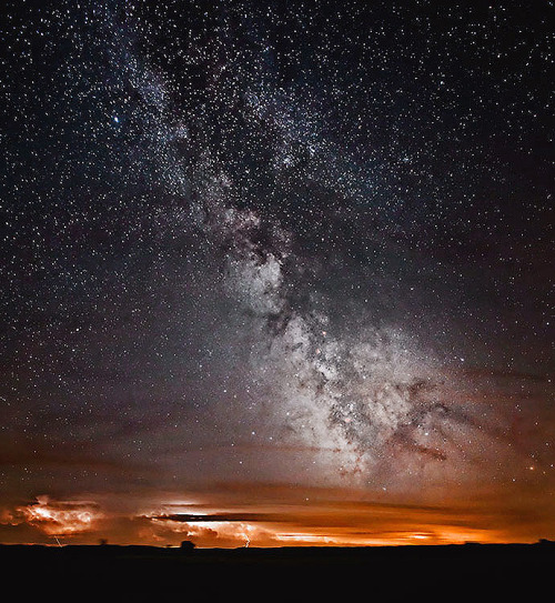 cwnl:  Milky Way over Thunderstorm A scenic thunderous landscape is rivaled by the vastness and reverence of our home galaxy the Milky Way in this timely shot. Image Copyright: Kevin Black