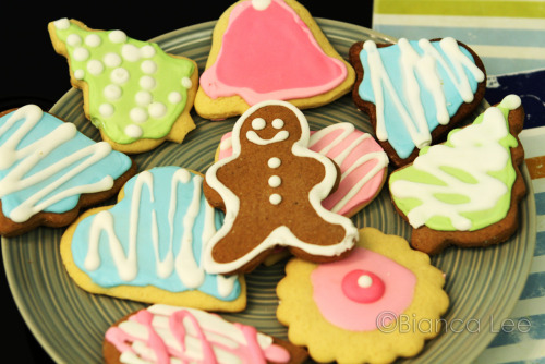 Sugar Cookies +gingerbread cookies with royal icing Credits! Sugar Cookie Recipe  1/2 cup butter, softened salted 1/2 cup sugar 1 egg 1 teaspoon vanilla extract 1 cup flour 1 teaspoon baking powder Beat butter with sugar until smooth, add egg and vanilla, beat. Stir in flour, baking powder. Form into dough, if too sticky add more flour until it's firm enough to wrap into dough. Chill 1 hour. 200C. Roll it out, cut into shapes. Put on pan with baking paper Bake 10 minutes. Gingerbread Cookie Recipe 100g flour 100g butter softened 120g sugar 2 eggs 2tsp ginger 1tsp: nutmeg, cloves, cinnamon Beat butter and sugar until smooth, add eggs, mix in flour and all the spices. Form into dough. If sticky, add flour until it's not. Chill 1 hr. 180C. Roll out, cut shapes. Put on baking sheet on pan. Bake for 10 minutes Royal Icing Recipe 2 egg whites 1tsp lemon juice 3 cups icing sugar sifted food colouring Beat whites with lemon juice until foamy, add icing sugar, beat until smooth. For the outlining icing (optional it makes it easier to flood the centre with icing)= keep beating until it's thick, like soft/stiff peaks for cream For flooding icing: the icing that you fill the cookie cut out with, just beat until it's ribbon like, very flowy and liquidy. Add desired food colouring. Pipe! it hardens in around 30 minute room temperature, 15 minutes refrigerator.