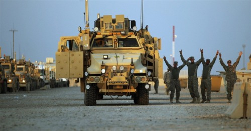 thepoliticalnotebook:  The last US troops have crossed from Iraq into Kuwait… making this war at which we've spent a decade officially over. There's a lot not to be optimistic about when it comes to post-war reconstruction Iraq, but right now, having the last soldiers off Iraqi soil is an amazing moment to take stock of.  Overnight, MRAP vehicles carried the last 500 soldiers into Kuwait. The last convoy left Iraq at daybreak, to cheering. NBC's Richard Engel was there, and tweeted:  His Twitter timeline at the moment is an amazing record of the last moments of our troop presence in Iraq. [Photo Credit: Mario Tama/Pool via EPA]