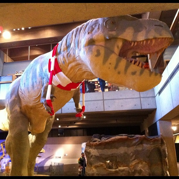 thememegeneration:  Happy holidays! (Taken with Instagram at Dinosaur Exhibit @ The Museum Of Science)  I'm more than a little dismayed that The Museum of Science in Boston would succumb to pressure from Creationists who believe that Christ lived among the dinosaurs. Disgraceful.