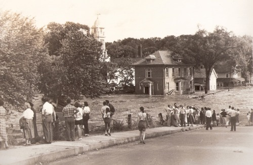 The Naugatuck River overflowed on Aug. 19, 1955. Here, at the corner of Broad Street and Derby Avenue, residents watch the water flow through a church and home. This is one of several photos I'm posting to History Pin as part of my Master's captsone project. It was sent to me by Carl McCluskey, a resident of Gerogia who found a stash of flood photos in his father's home when his father passed away.