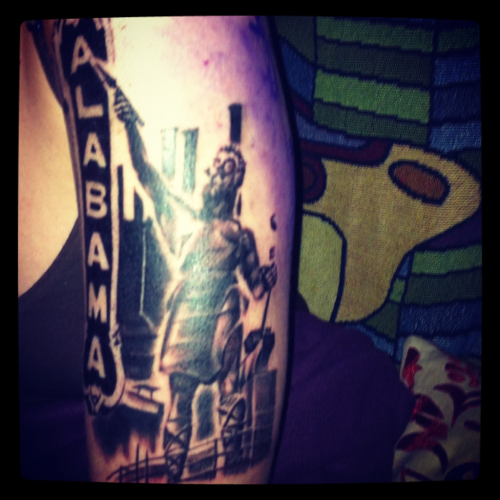 The first half of my tattoo…. It's my favorite landmarks/places from my hometown Birmingham Alabama: Sloss Furnace, The Vulcan, The Alabama Theatre, The Nick, Cosmos Pizza.