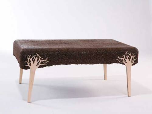 Shaving coffee table by Yoav Avinoam  Shlving table is made of sawdust waste from the wood industry. The sawdust (taken from different kinds of woods) is being pressed with resin into a mold that already contains all of the object parts