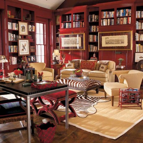 A wonderful study or home library, with red, book-lined walls, and different upholsteries, such as plaid and zebra stripe (via Eclectic Study )