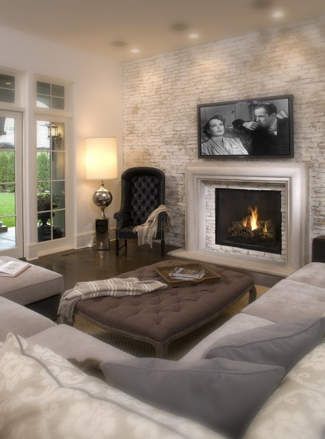This softly lit neutral Hollywood Chic living room looks like something from a dream (via John Kraemer & Sons)