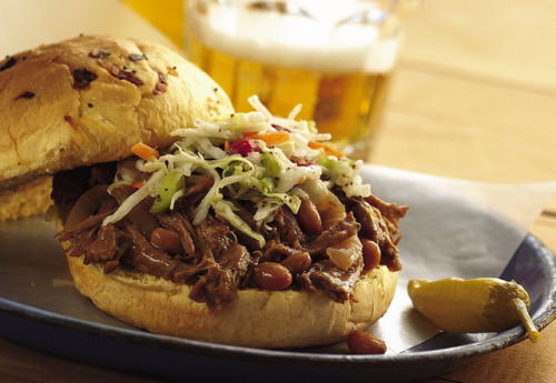 Slow Cooker Cowboy Beef and BBQ Bean Sandwiches by Pillsbury.com on Flickr. INGREDIENTS: 2 medium onions, sliced 2-pound beef boneless arm roast, trimmed of fat 1 can (16 ounces) baked beans 1/4 cup barbecue sauce 1 teaspoon finely chopped jalapeño chili 12 onion kaiser rolls, split 1 1/2 cups prepared coleslaw DIRECTIONS: 1. Place onions in 3- to 4-quart slow cooker. Add beef. Top with baked beans and barbecue sauce. 2. Cover and cook on low heat setting 8 to 10 hours. 3. Remove beef from cooker; place on cutting board. Shred beef, using 2 forks. Return beef to cooker and mix well. Stir in chili. To serve, place 1/2 cup beef mixture in each roll and top with 2 tablespoons coleslaw.