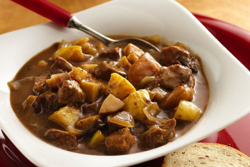 Slow Cooker Harvest Pork Stew Recipe by Pillsbury.com on Flickr. INGREDIENTS: 2 lb boneless pork shoulder roast, trimmed of fat, cut into 1-inch pieces 2 medium parsnips (about 12 oz), peeled, chopped (about 2 cups) 1 large red onion, cut into 1-inch pieces (about 3 cups) 1 cup dried apricots (6 oz) 1 cup pitted dried plums (6 oz 1/4 cup all-purpose flour 1/2 teaspoon salt 1/2 teaspoon pepper 1/4 teaspoon ground cloves 3 1/2 cups Progresso® chicken broth (from 32-oz carton) 1 cup apple cider 2 large Golden Delicious apples (about 1 1/4 lb) DIRECTIONS: 1. Spray 5- to 6-quart slow cooker with cooking spray. In cooker, mix pork, parsnips, onion, apricots and plums. Add flour, salt, pepper and cloves; toss until pork, vegetables and fruit are coated. Add broth and cider; mix well. 2. Cover; cook on Low heat setting 7 to 9 hours. 3. Core apples; cut each into large chunks. Stir apples into stew. Cover; cook on Low heat setting 1 hour longer. Stir well before serving. Be sure to purchase the correct cut of pork for this stew. The shoulder roast is a tough cut of pork that needs to be braised, or cooked slowly in liquid, to become tender. If you use a cut that's already tender, such as a pork loin roast, braising will make it tough and dry. If you like, you can substitute 3 carrots for the parsnips.