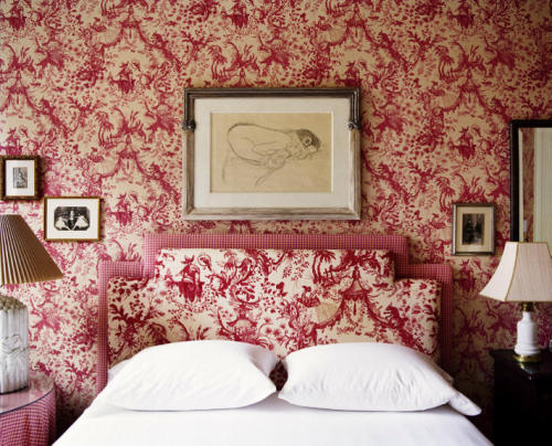 Red toile print wallpaper and matching upholstered headboard