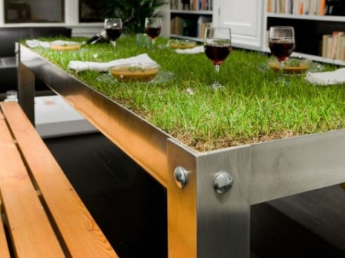 "Life-Altering Picnic Table of the Day: Bring the outdoors inside with The picNYC Table from Haiko Cornelissen Architecten. ""Suddenly, spilling water becomes a necessity instead of a problem and wine glasses need coasters not to prevent ring stains but to avoid tumbling,"" say the table's designers. The vegetation is very much alive, meaning the table requires constant care, but the reward is invaluable: All the picnic with none of the f*cking ants. [architizer / thd.]"