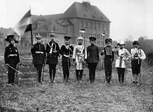 hatsfromhistory:  chrisjonesing:  School boys in Germany celebrating the Kaiser's birthday, 1915  Look at those adorable wee pickelhaubes!