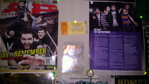 Adtr part of wall with signatures on pokemon card. ((: