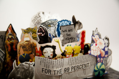 This one is for the other 99%. Another pop-up book made with found paper around town.