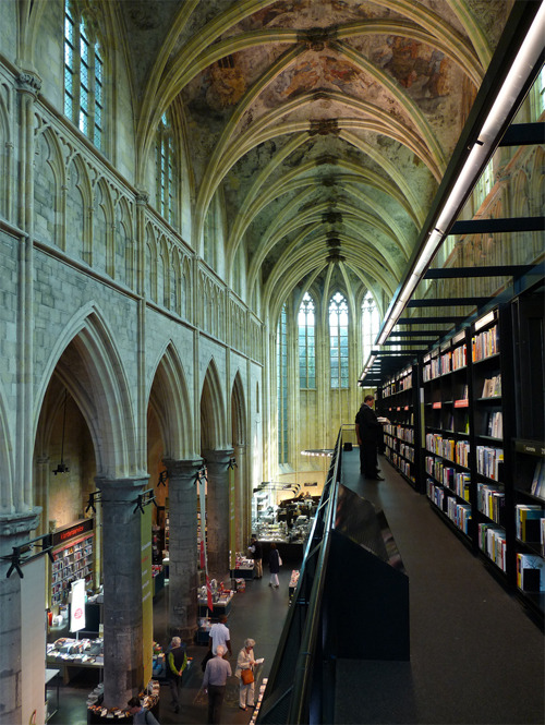 bookmania:  Boekhandel Selexyz Dominicanen in Maastricht, The Netherlands. The Boekhandel Selexyz Dominicanen is a bookshop which was once a Dominican church. Years ago, the church was still a place for people to park bicycles in Maastricht, Netherlands. Architectural firm Merkx+Girod designed the church by altering the interiors a little by adding modern elements and keeping the original architectural style. Successfully opened on Christmas day of the year 2006, Selexyz offers a wide range of popular books and books for professionals. (photo by Ana Compadre)