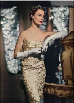 hollyhocksandtulips:  Strapless gold brocade evening gown, 1950