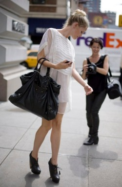 White Sheer IMITATION OF CHRIST Dress with Big Black BALENCIAGA Bag and Black Booties