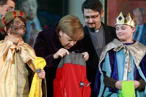 Angela Merkel was really exited to meet Santa at the Christmas party. But when she arrived she was just handed a costume and a sack and told to go and change quickly and now she feels shocked and disillusioned.