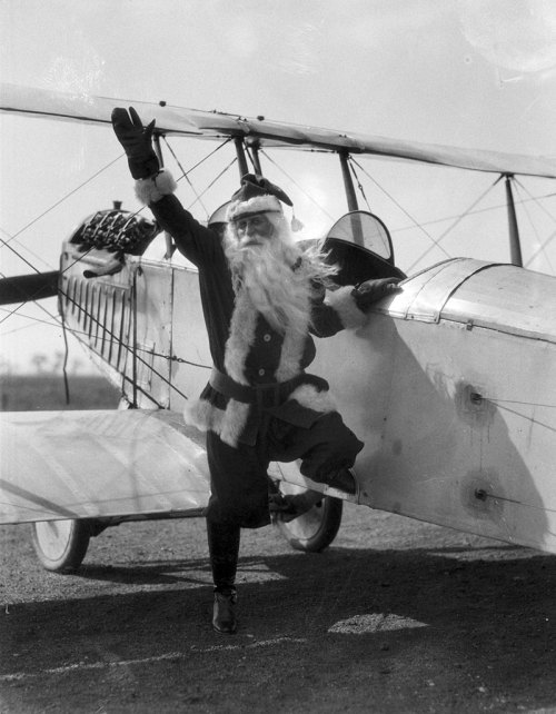 "chicagohistorymuseum:  Not even Santa Claus could resist the excitement over ""Lucky Lindy"" and air travel. Here Santa tries out a substitute for his sleigh just months after Charles Lindbergh's famous 1927 transatlantic flight. Want a copy of this photo?  > Visit our Rights and Reproductions Department and give them this number: iChi-03166. Want to buy a book?> Purchase Historic Photos of Christmas in Chicago"
