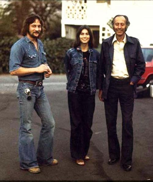 roseofcimarron:  Gene Clark, Emmylou Harris and Eddie Tickner (The Byrds' co-manager) in 1976 Photo by Torbjörn Calvero This is so amazing to me to finally see Emmylou and Gene together. Emmylou sang backing vocals on Gene's song Sister Moon. In Gene's biography it doesn't mention them being friends but does say she was there at a party where Gene got horribly and nastily drunk and I often wonder if that's why she never covered any of his songs.