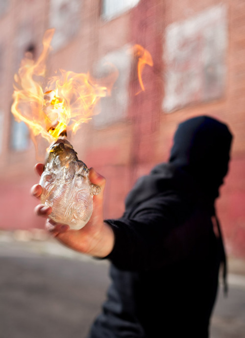 A glass human heart-shaped Molotov cocktail. (If you have to blow something up, do it with heart!)