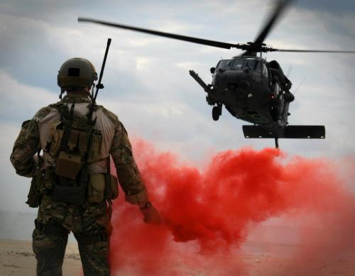 soldierporn:  Pink mist or Red Air… victran:  U.S. Air Force Maj. Matthew McGuinness pops a flare to signal an Air Force HH-60G Pave Hawk search and rescue helicopter where to land Dec. 5, 2011, during Exercise Cope Angel 12 in Okinawa, Japan. The 33rd and 31st Rescue Squadrons paired up with partners from the Japan Air Self-Defense Force during Cope Angel to train on water and land rescue and triage tactics. McGuinness is the 31st Rescue Squadron director of operations. (U.S. Air Force photo by Airman 1st Class Maeson L. Elleman)