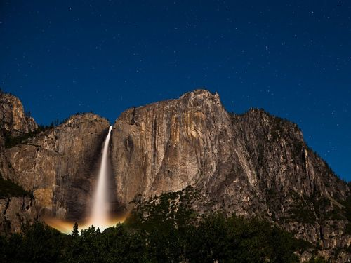 nationalgeographicdaily:  Upper Yosemite Falls, CaliforniaPhoto: Andrew Coffing This 30-second exposure revealed a moonbow hidden in the mist at the foot of the falls. The full moon and clear sky made for a perfect photo op from the Yosemite Valley floor.