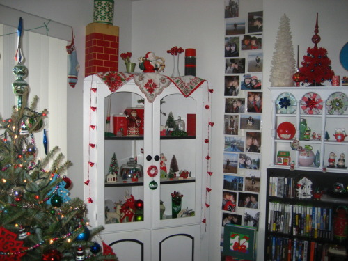 Some of my christmas decorations! part of the tree, corner cabinet, and small shelf thing. So pretty, right?