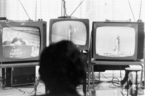 Rabbit ears lightthiscandle:  Annie Glenn watches launch coverage of her husband John's Friendship 7 mission.