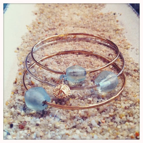 14k Gold Filled and Sterling Silver Hammered Bangles with sea glass beads and gold sand dollar charms  details at http://shellchic.blogspot.com