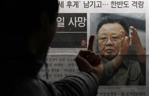 hiddenpublic:  A man reacts at a picture of North Korean leader Kim Jong-il as he reads the reports of his death on the newspaper company's display board in Seoul December 19, 2011. by: Kim Kyung-Hoon, Reuters