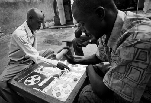 Ugandan men playing Ludo.   © 2007 Dominick Reuter