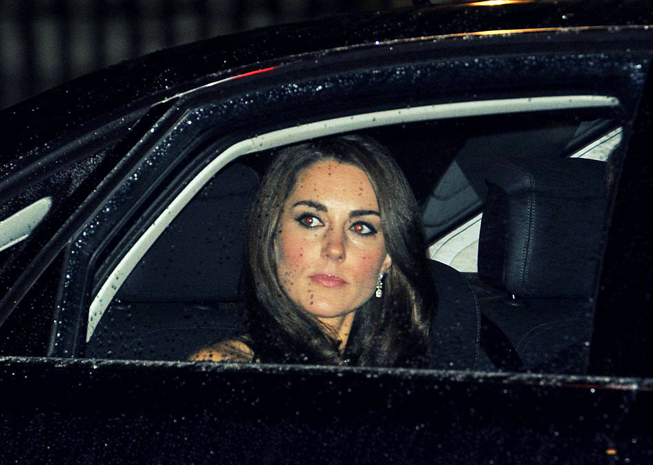 Kate, looking out her car window as she arrives at the 2011 Military Awards with her husband, Prince William.