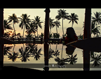 coconut trees, a woman and a reflecting dining table..(explored, frontpage) by PNike on Flickr.