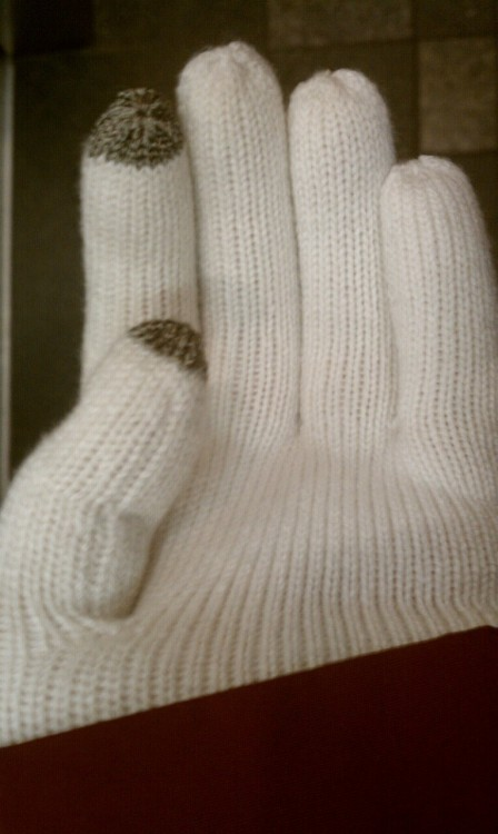Conductive thread in my new gloves! Can use my touch phone when its cold.