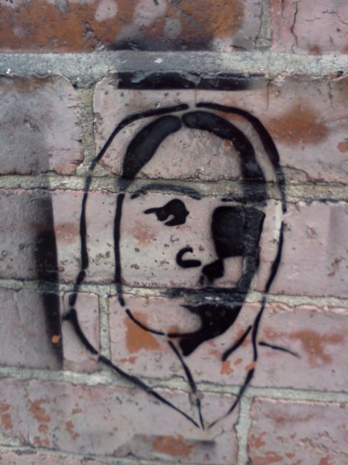 Beautiful unknown moslema face on a wall in Auckland