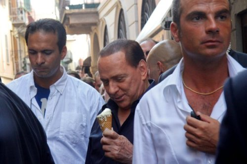 Silvio Berlusconi eating an ice cream.