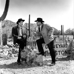 Kirk Douglas and Burt Lancaster talk between scenes on the set of Gunfight at the O.K. Corral, April 1956.
