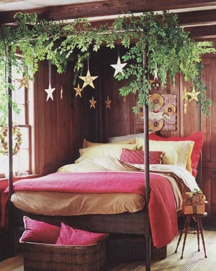 A rustic country four-poster bed gets decorated with fresh greenery and hanging stars… I think this would feel like sleeping outdoors, under the open sky.