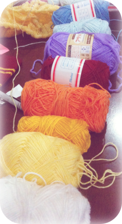 30 Day Knitting ChallengeDay 9: What fibre or yarn do you love working with? I don't really have a set preference for yarn quite yet, but I'm pretty okay with anything I'm working with. Currently, I'm in that trial-and-error stage where I buy some new yarn, get to know the imperfections, and use it anyway. lollol. I've only started buying other brands of yarn quite recently. (mostly because before this, I was pretty occupied with getting that Gryffindor scarf finished) The only time I can actually buy yarn is when I'm at college, ironically. There's a place across the street and it's the only yarn store I like buying from. mostly because the store-owners of other yarn stores in my area are TOTAL snobs and sharks… It's okay, they can be rude… I just won't buy from them. lol So yeah, I'm kinda stuck with these guys here till Christmas break ends. *cuddles skeins* :3 The Gryffindor scarf: |here| and |here|