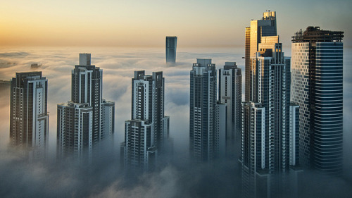 Foggy sunrise in Dubai #2 by momentaryawe.com on Flickr.