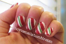 Candy Cane Nails! After a weekend of making Christmas cookies I figured I do something a little festive for my nails.   Colors:OPI - Big Apple RedWet 'n Wild - French White CreameMilani Nail Art - Sketch Green China Glaze - Fairy Dust