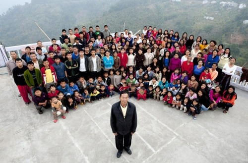 Peculiar Picture: This man from Mizoram, India has the world's largest family! Ziona Chana is the 'proud' head of a huge sized family of 39 wives, 94 children, 14-daughters-in-laws and 33 grandchildren. To lodge his huge family he has constructed a 100-room, four storey building in Baktwang village. It almost looks like a hotel.
