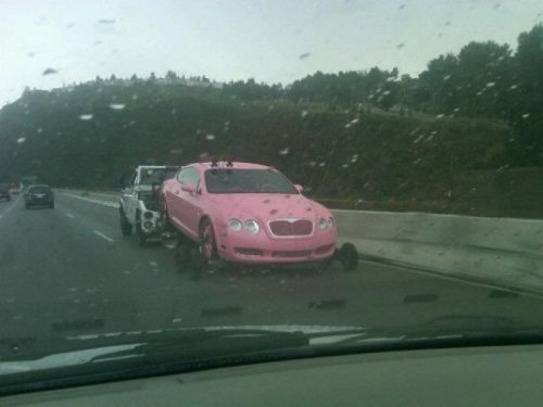 Wow… Barbie's car in real life! But seriously, who would actually drive a car that color, I understand that you love pink in all, but really?! Your going to the extremes here! collegehumor:  Hot Pink Bentley Being Towed That's the closest the tow truck driver has ever been to that color.