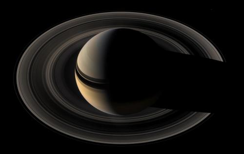 usagov:  Image description: Saturn and its rings cast striking shadows on each other in this mosaic of images captured by NASA's Cassini spacecraft. The view combines 45 images taken over the course of about two hours, as Cassini scanned across the entire main ring system from a distance of about 1.1 million kilometers (700,000 miles). Image by NASA/JPL/Space Science Institute