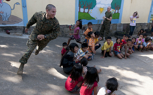 Image description: In Sihanoukville, Cambodia, Sgt. Marcos Bustos joins in the fun during a community service event at the Help the Cambodian Children Goodwill Center.  Sgt. Bustos is assigned to the 11th Marine Expeditionary Unit and aboard the USS Pearl Harbor. Photo by U.S. Navy Photo by Mass Communication Specialist 2nd Class Dominique Pinerio